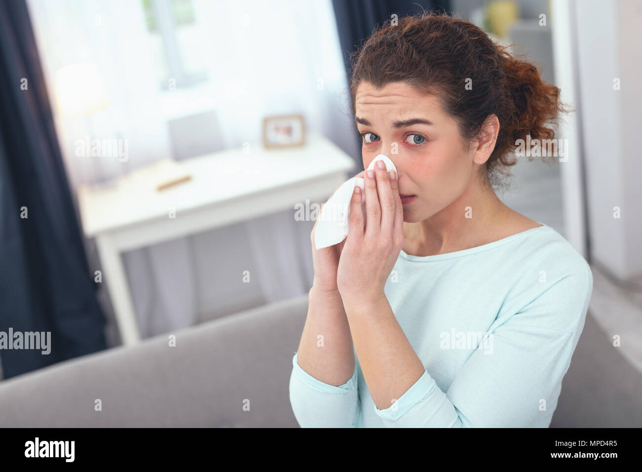 Sick lady suffering from an unknown allergic reaction - Stock Image