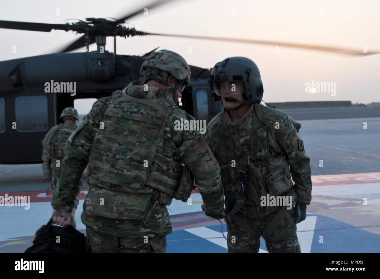 Brig. Gen. Robert D. Harter, deputy commanding general of the 1st Sustainment Command (Theater) / commanding general of the 316th Sustainment Command (Expeditionary), prepares to board a UH-60 Black Hawk at Camp Arifjan, Kuwait, on February 4, 2017. (U.S. Army photo by Staff Sgt. Dalton Smith) - Stock Image