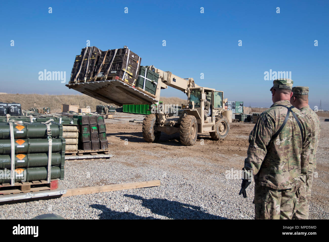 Brig. Gen. Robert D. Harter, deputy commanding general of the 1st Sustainment Command (Theater) / commanding general of the 316th Sustainment Command (Expeditionary), inspects the multi-national ammunition supply depot at Erbil, Iraq, on February 3, 2017. (U.S. Army photo by Staff Sgt. Dalton Smith) - Stock Image