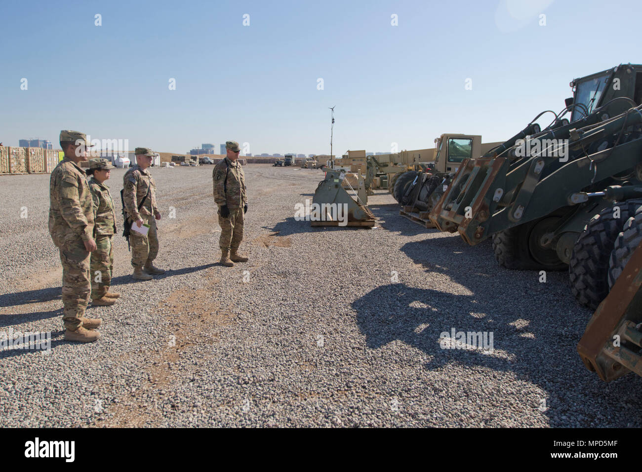 Brig. Gen. Robert D. Harter, deputy commanding general of the 1st Sustainment Command (Theater) / commanding general of the 316th Sustainment Command (Expeditionary), inspects the Movement Control Team's staging yard at Erbil, Iraq, on February 3, 2017. (U.S. Army photo by Staff Sgt. Dalton Smith) - Stock Image