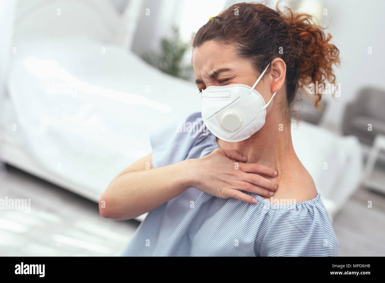 Young lady suffering from flu complications - Stock Image