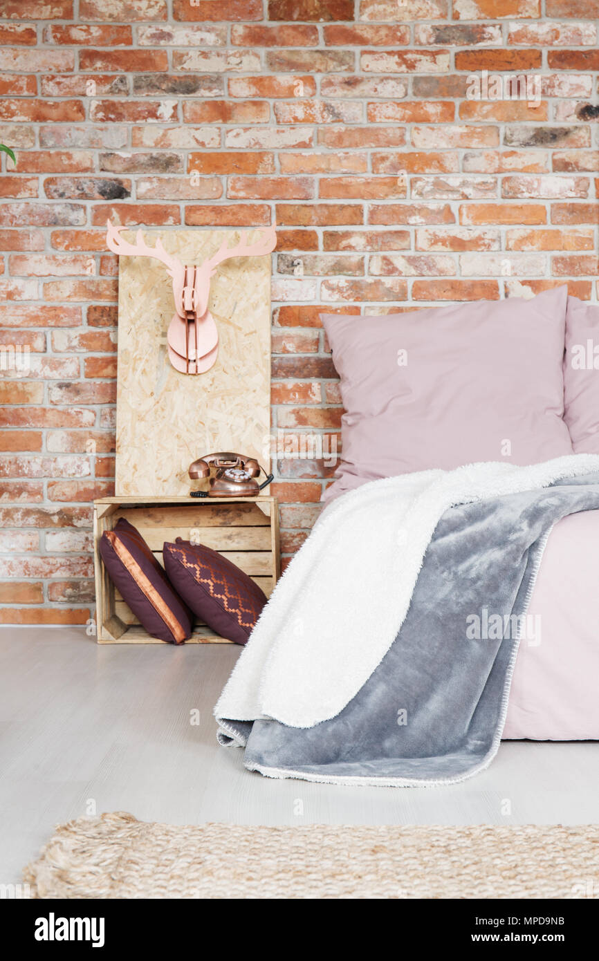 Modern Bedroom With Crate Nightstand And Brick Wall Stock Photo Alamy