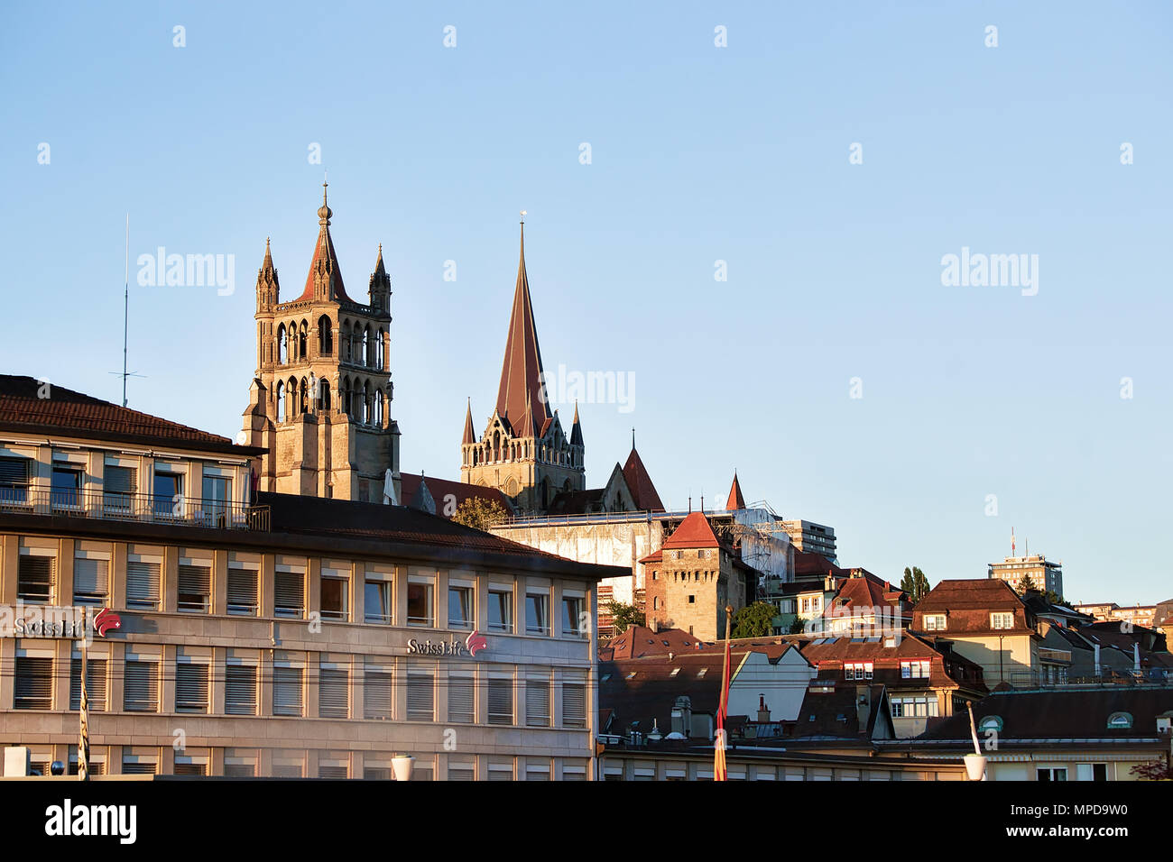 Lausanne, Switzerland - August 26, 2018: Lausanne Cathedral of Notre Dame in Lausanne city center, Switzerland. Seen from Le Flon district - Stock Image