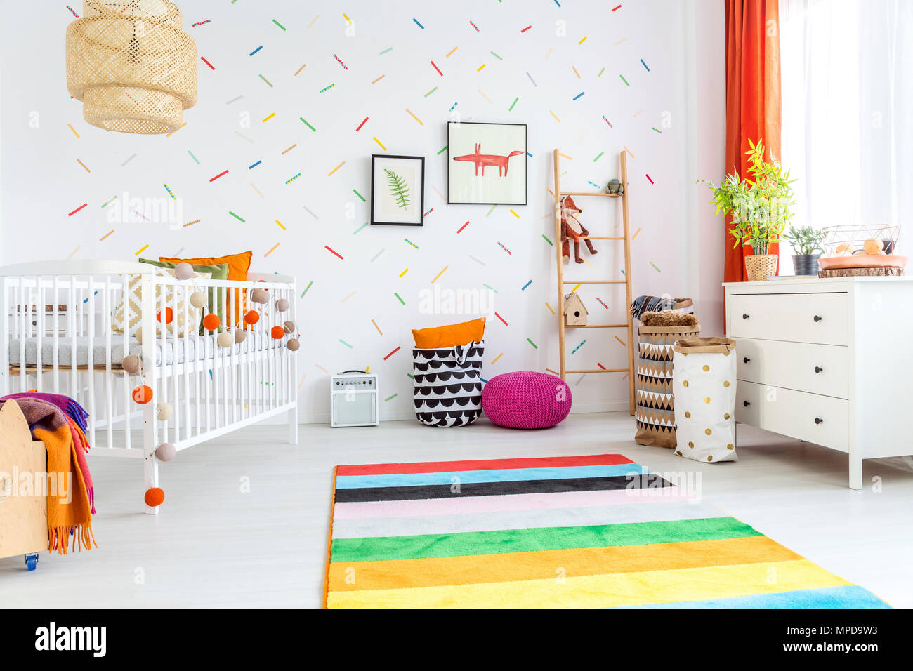 White Baby Room With Cot And Colorful Rug Stock Photo Alamy