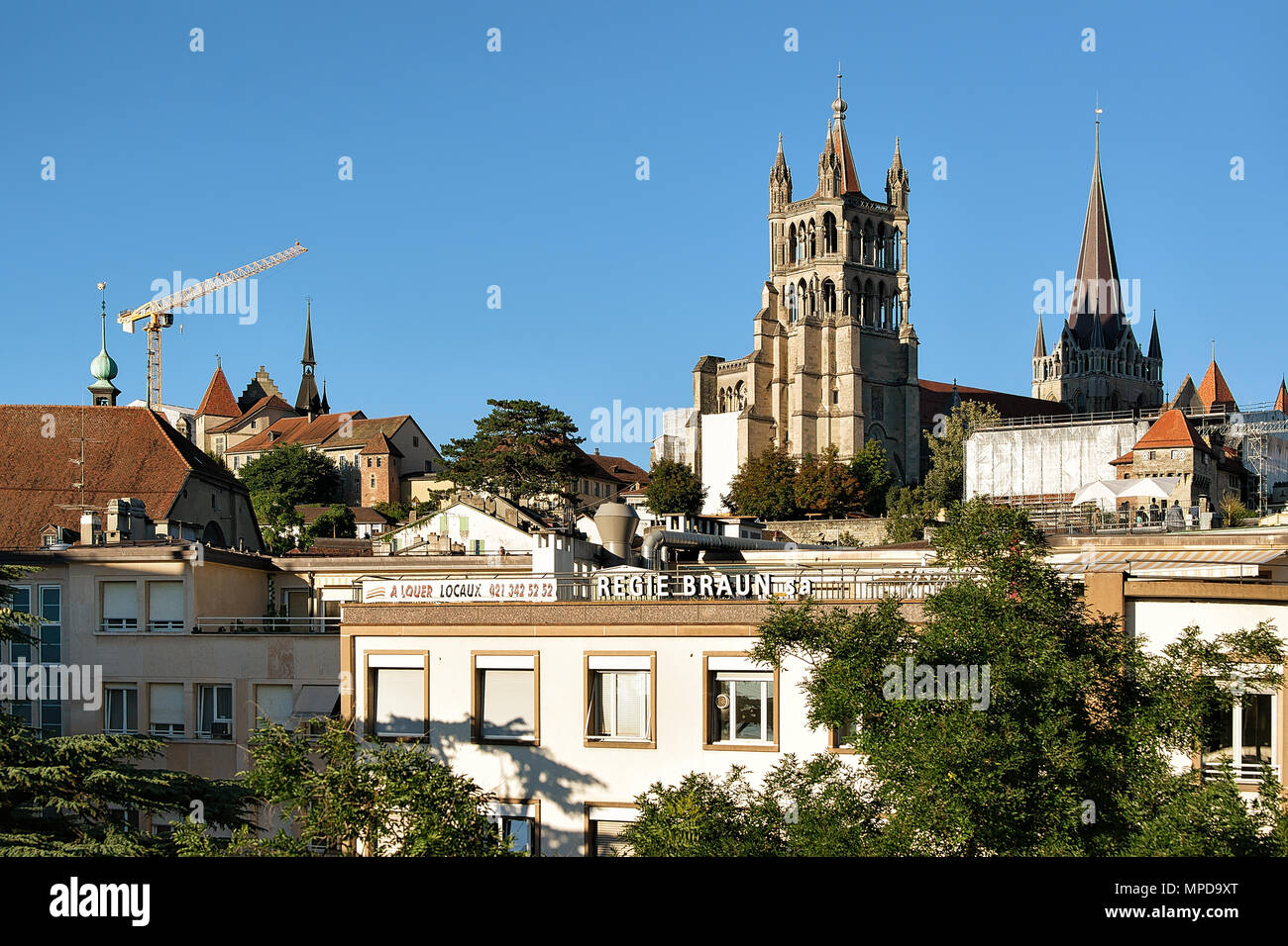 Lausanne, Switzerland - August 26, 2018: Cathedral of Notre Dame in Lausanne, in Switzerland. Seen from Le Flon district - Stock Image