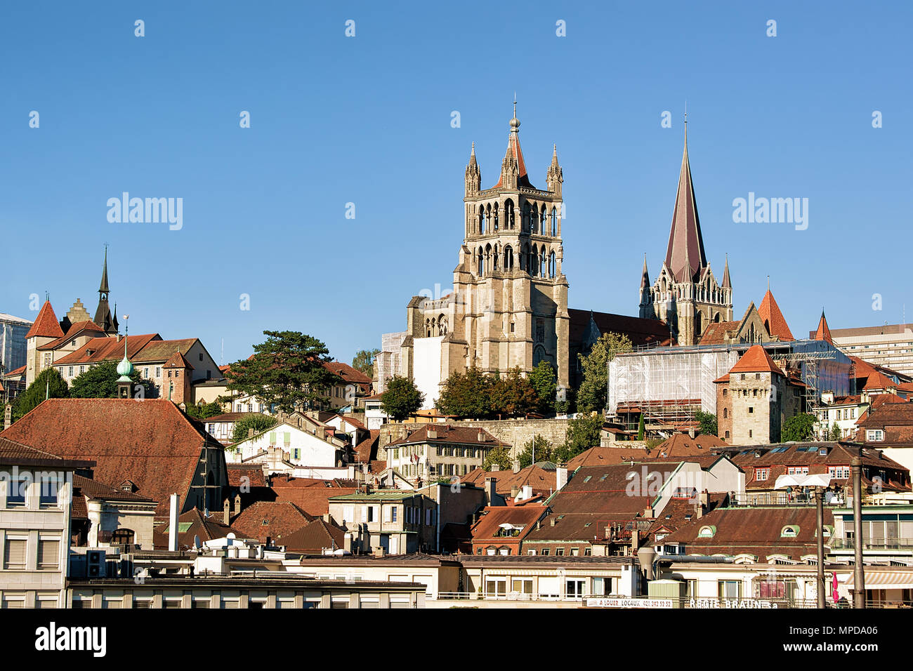 Lausanne, Switzerland - August 26, 2018: Cathedral of Notre Dame in Lausanne, Switzerland. Seen from Le Flon district - Stock Image