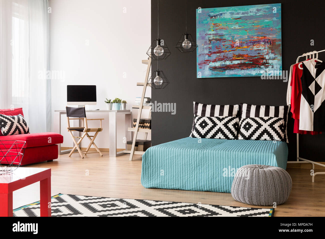 Spacious Black And White Flat In A New Style With Large Bed And Small Office Area Stock Photo Alamy