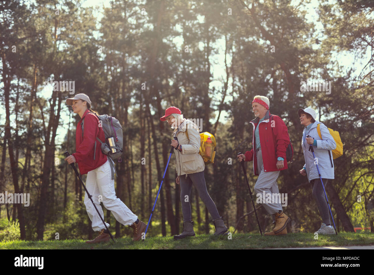 Alert guide leading her team of hikers - Stock Image