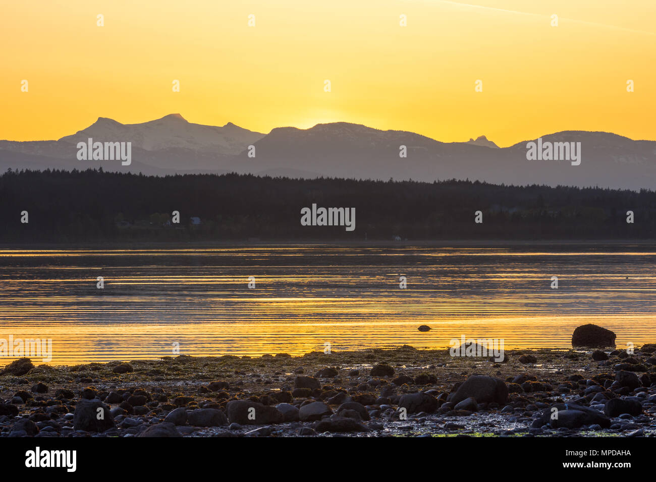 Sunset looking towards Vancouver Island from Hornby Island, BC, Canada. - Stock Image