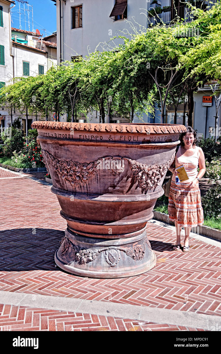 Enormous Flower Pot and Lady - Stock Image