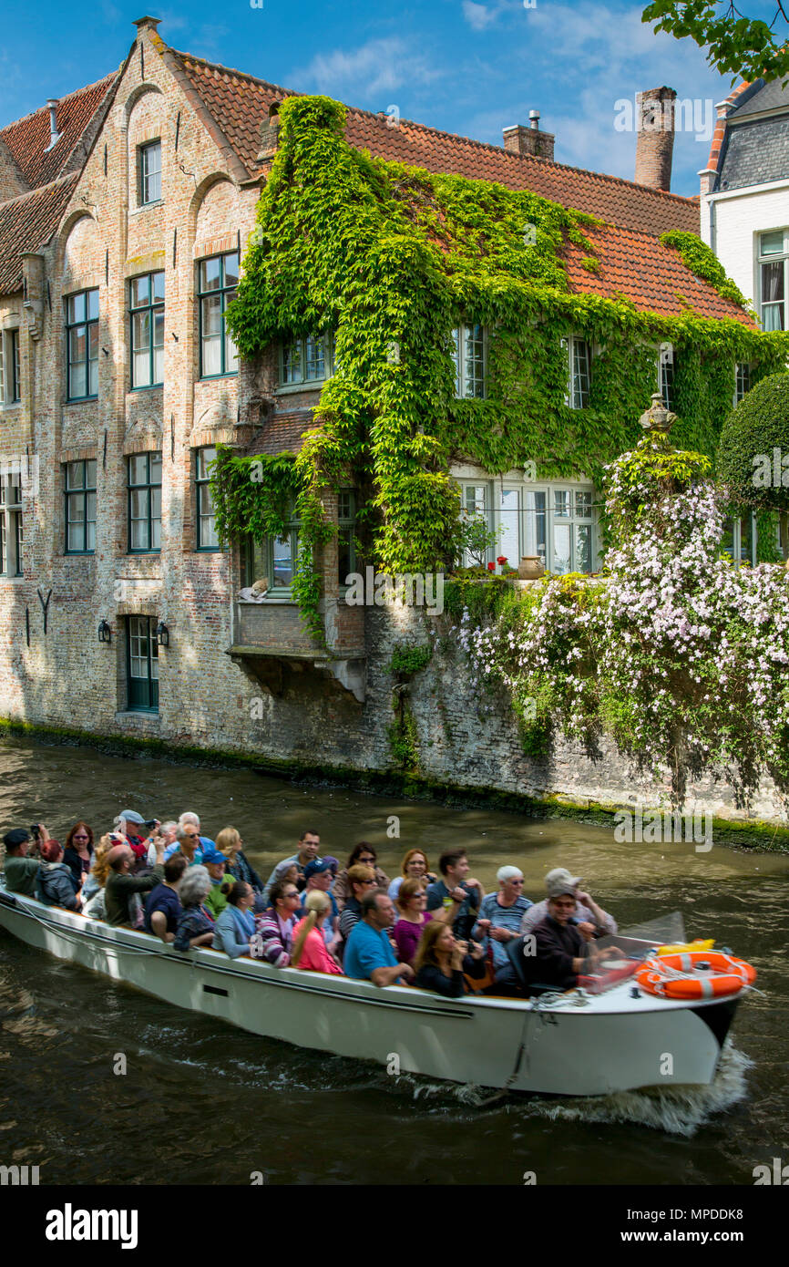 Tourist boat on Canal Groenerei in the medieval city of Bruges, Belgium - Stock Image