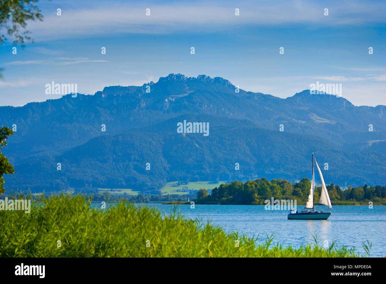 Lake Chiemsee with sailboat and mountain Kampenwand in the background, Bavaria, Germany, Europe Stock Photo