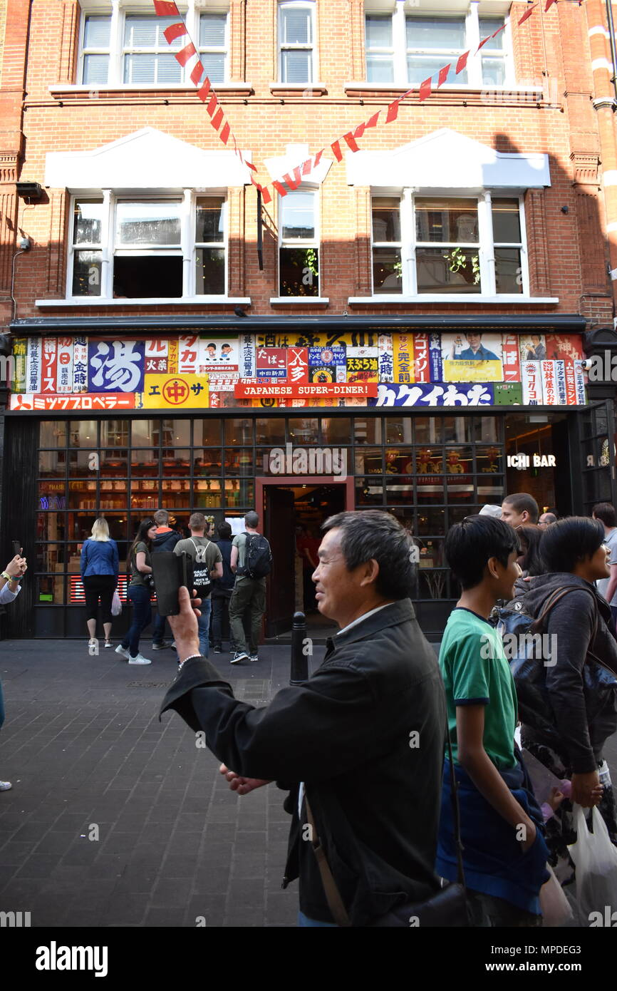 American tourist admiring the architecture in China town, London, England, 20th May 2018 - Stock Image