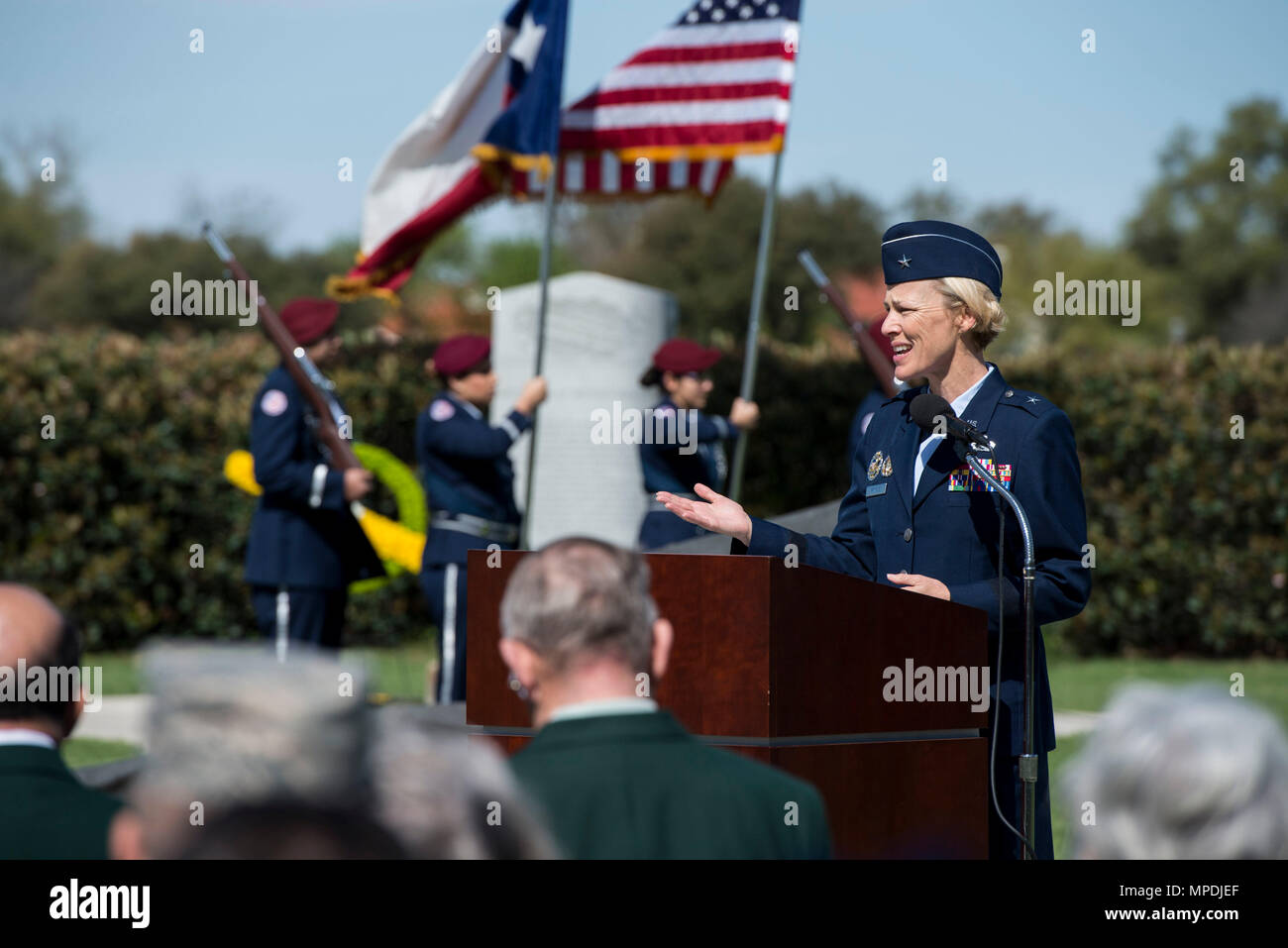 U.S. Air Force Brig. Gen. Heather Pringle, 502nd Air Base Wing and Joint Base San Antonio commander, speaks during a ceremony celebrating the anniversary of the first flight of Army Signal Corps aircraft No. 1 March 2, 2017, at JBSA-Fort Sam Houston, Texas. First Lt. Benjamin Foulois is credited with completing the first military flight on March 2, 1910. (U.S. Air Force photo by Senior Airman Stormy Archer) - Stock Image