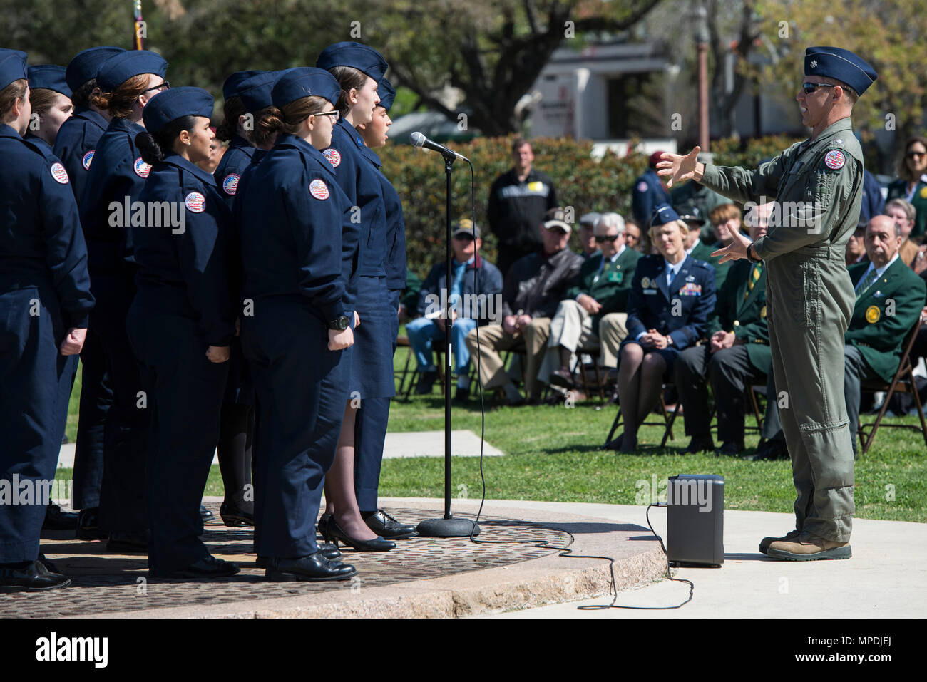 The Floresville High School Air Force Junior ROTC Chorale performs during and event celebrating the anniversary of the first military flight March 2, 2017, at Joint Base San Antonio-Fort Sam Houston, Texas. On March 2, 1910, then-Army Lt. Benjamin Foulois became the first person to make a military flight, from a military facility, in a government owned plane flown by a military-trained pilot. (U.S. Air Force photo by Senior Airman Stormy Archer) - Stock Image