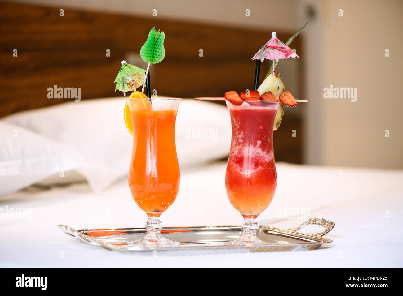 Two drinks on bed room hotel - Stock Image