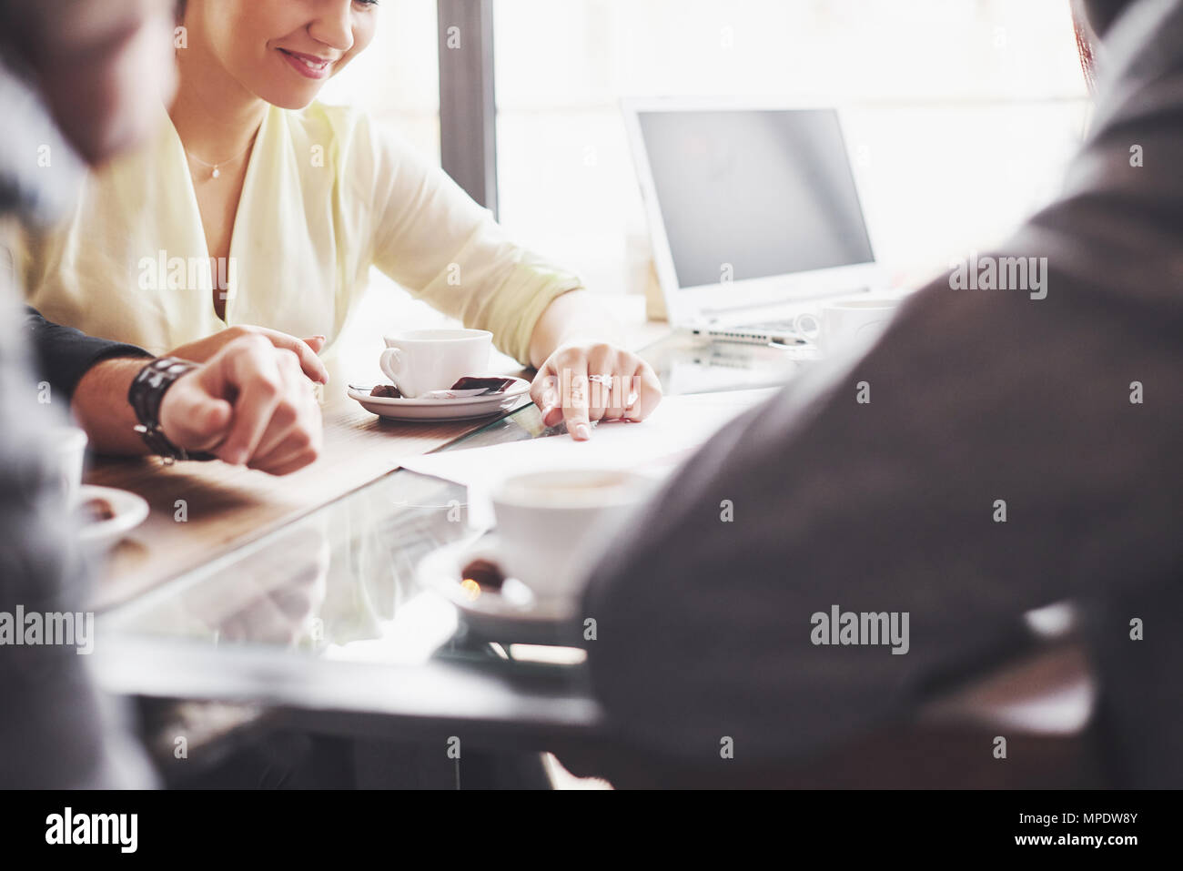 Group of casually dressed businesspeople discussing ideas. Creative professionals gathered for discuss the important issues of the new successful startup project. Teamwork Brainstorming Concept - Stock Image