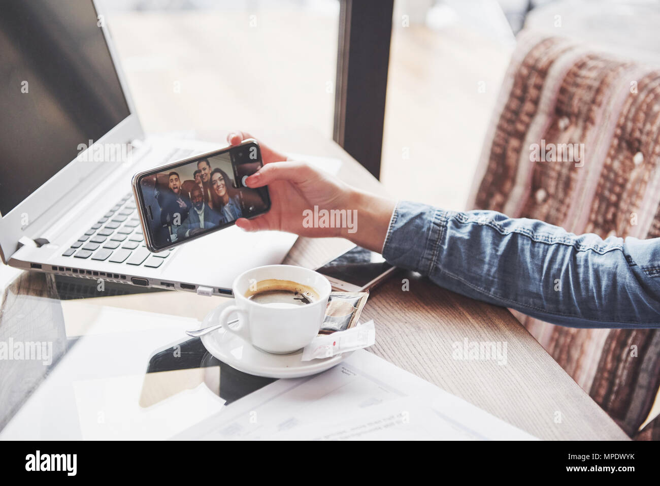 Selfie time. Handsome friends making selfie and smiling while resting at pub - Stock Image