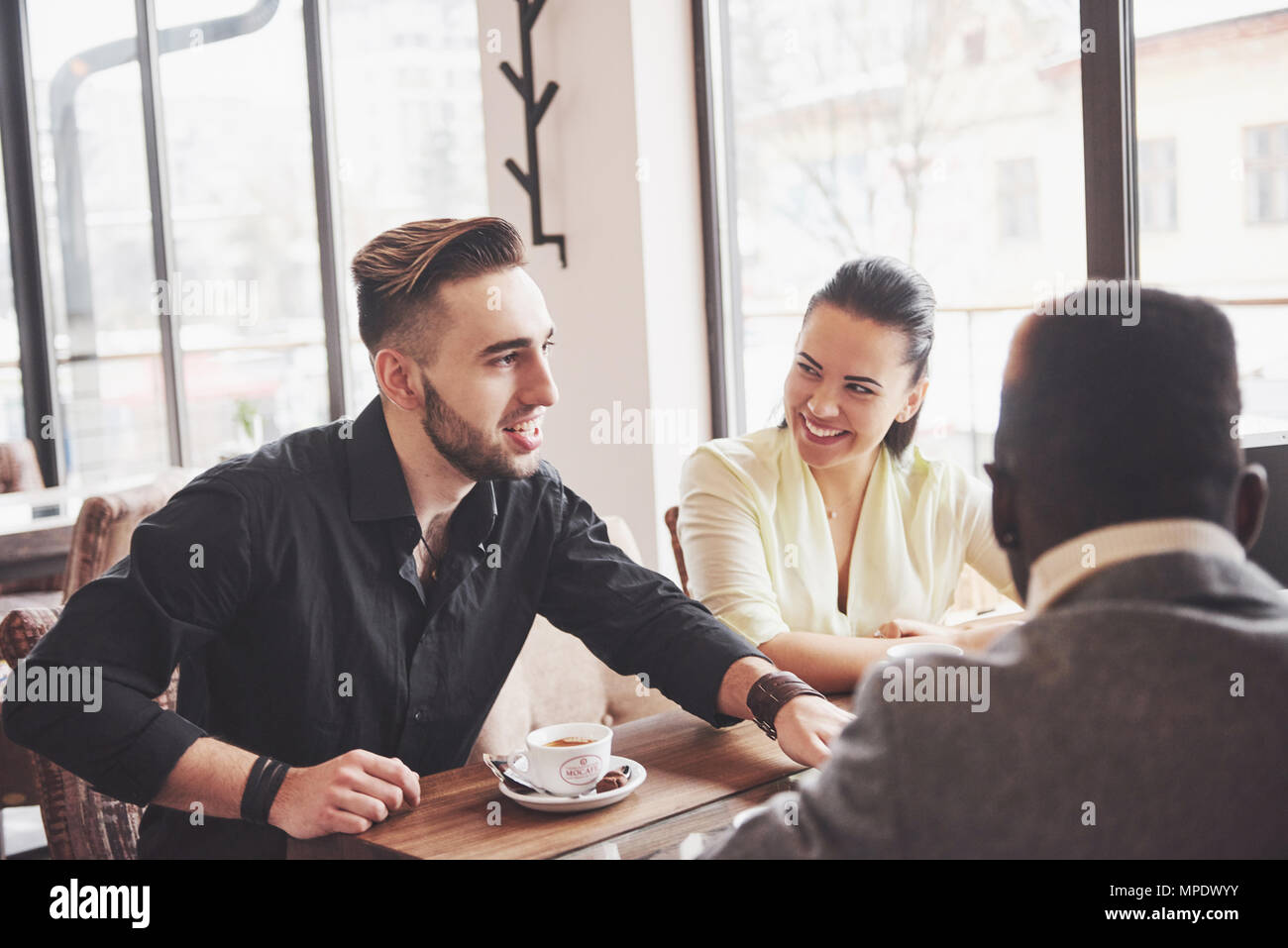 Startup Diversity Teamwork Brainstorming Meeting Concept. Business Team Coworkers Sharing World Economy Report Document Laptop.People Working Planning Start Up.Group Young Hipsters Discussing Cafe - Stock Image