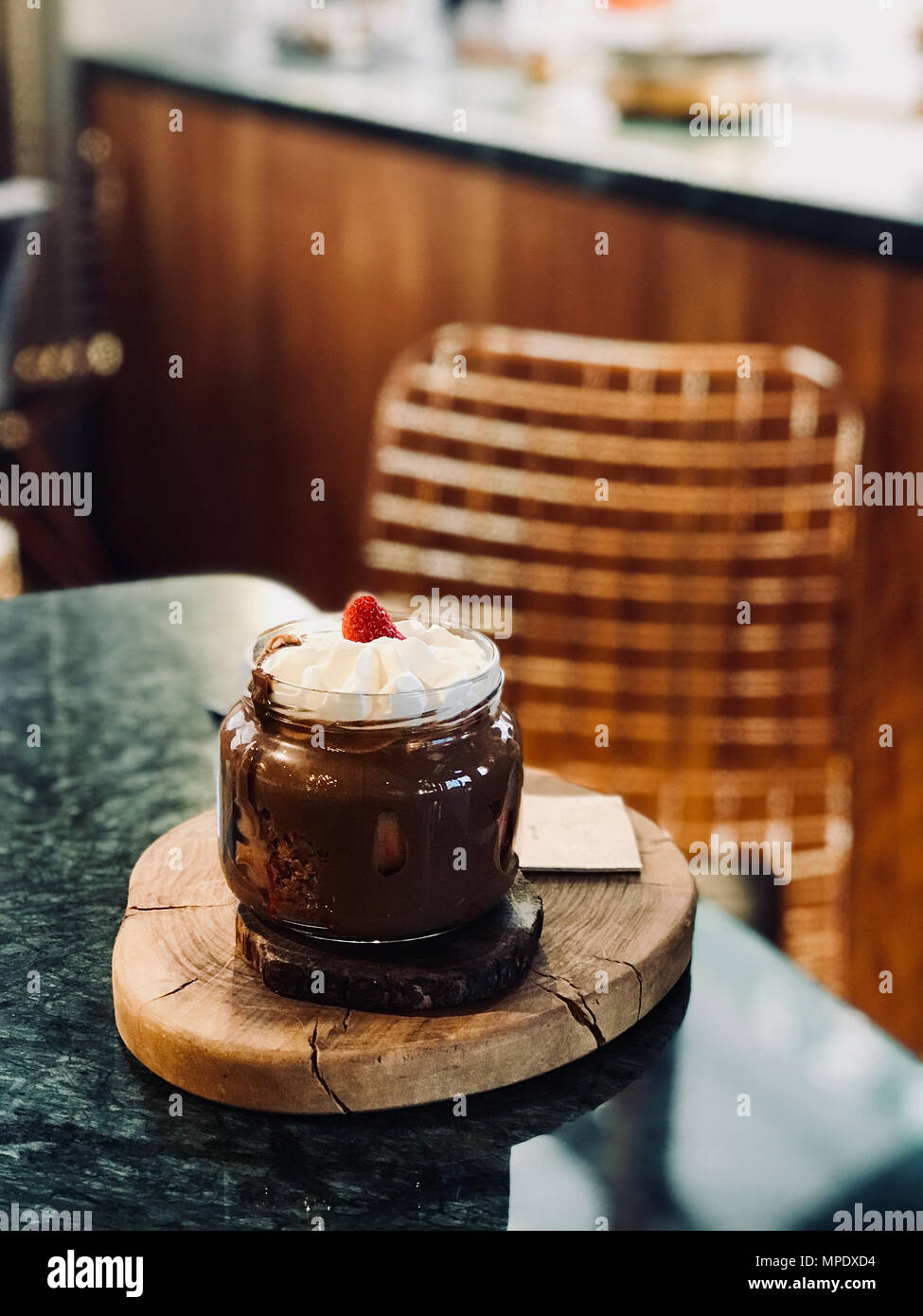Melted Belgium Chocolate Dessert with Whipped Cream and Strawberry in Jar served at Restaurant. Organic Dessert. Stock Photo