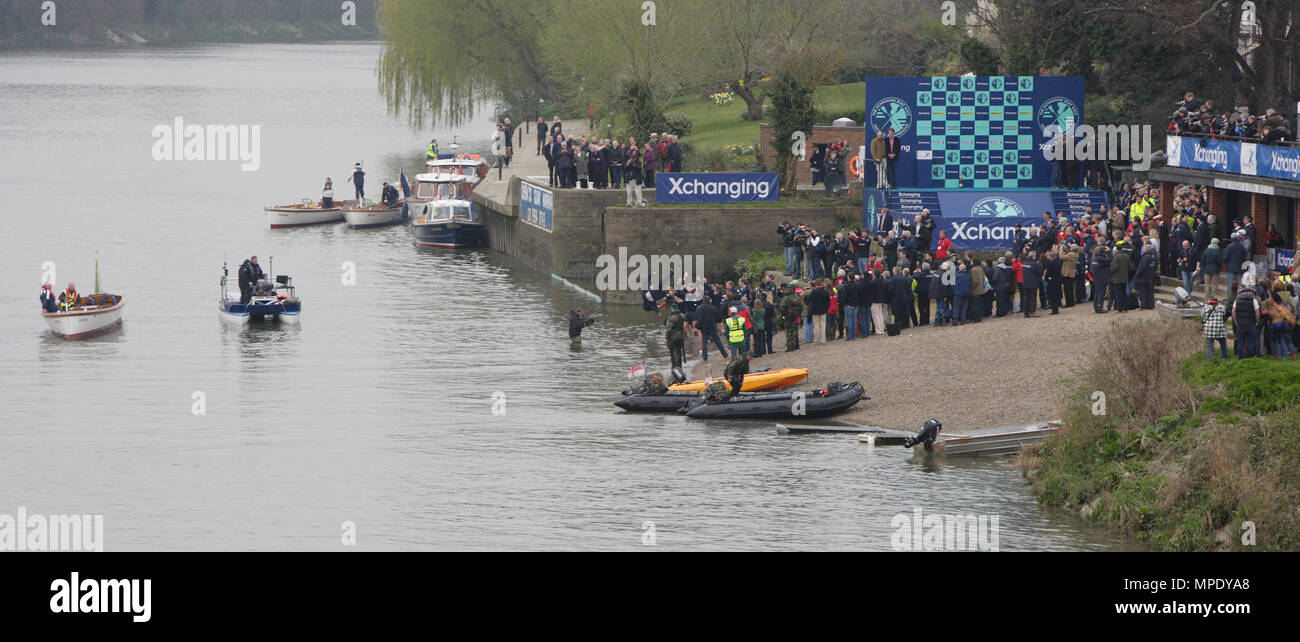 The Xchanging Boat Race, Oxford vs Cambridge University, the Oxford crew celebrate winning the 157th annual boat race with the traditional dunking the Cox in the water  - the Thames River, London, 26 March 2011 - Stock Image