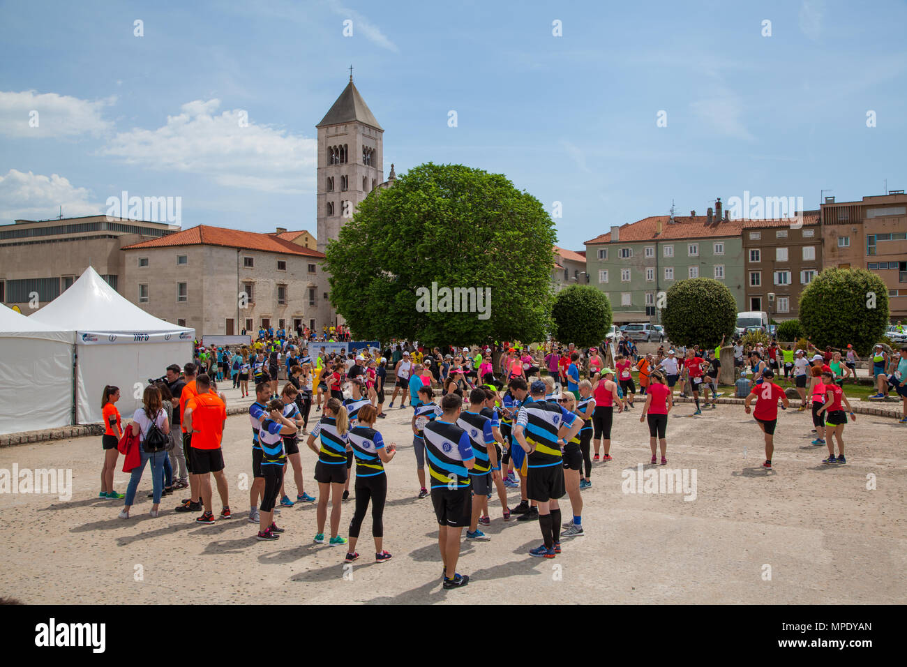 Runners athletes and competitors prepare and warm up for The Croatian staging of the global race, wings for life world run charity race in Zadar - Stock Image