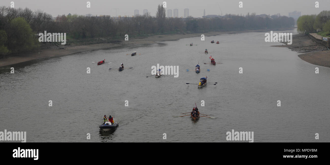 The Xchanging Boat Race, Oxford vs Cambridge University, the river is officially closed with a flotilla of boats, Thames River, London, 26 March 2011 - Stock Image