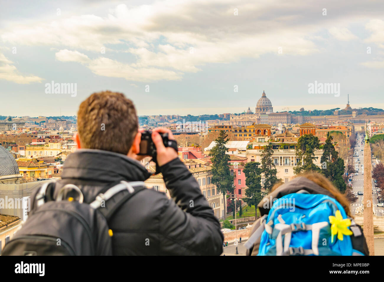 Couple taking photos of Rome cityscape from monte pincio viewpoint. - Stock Image