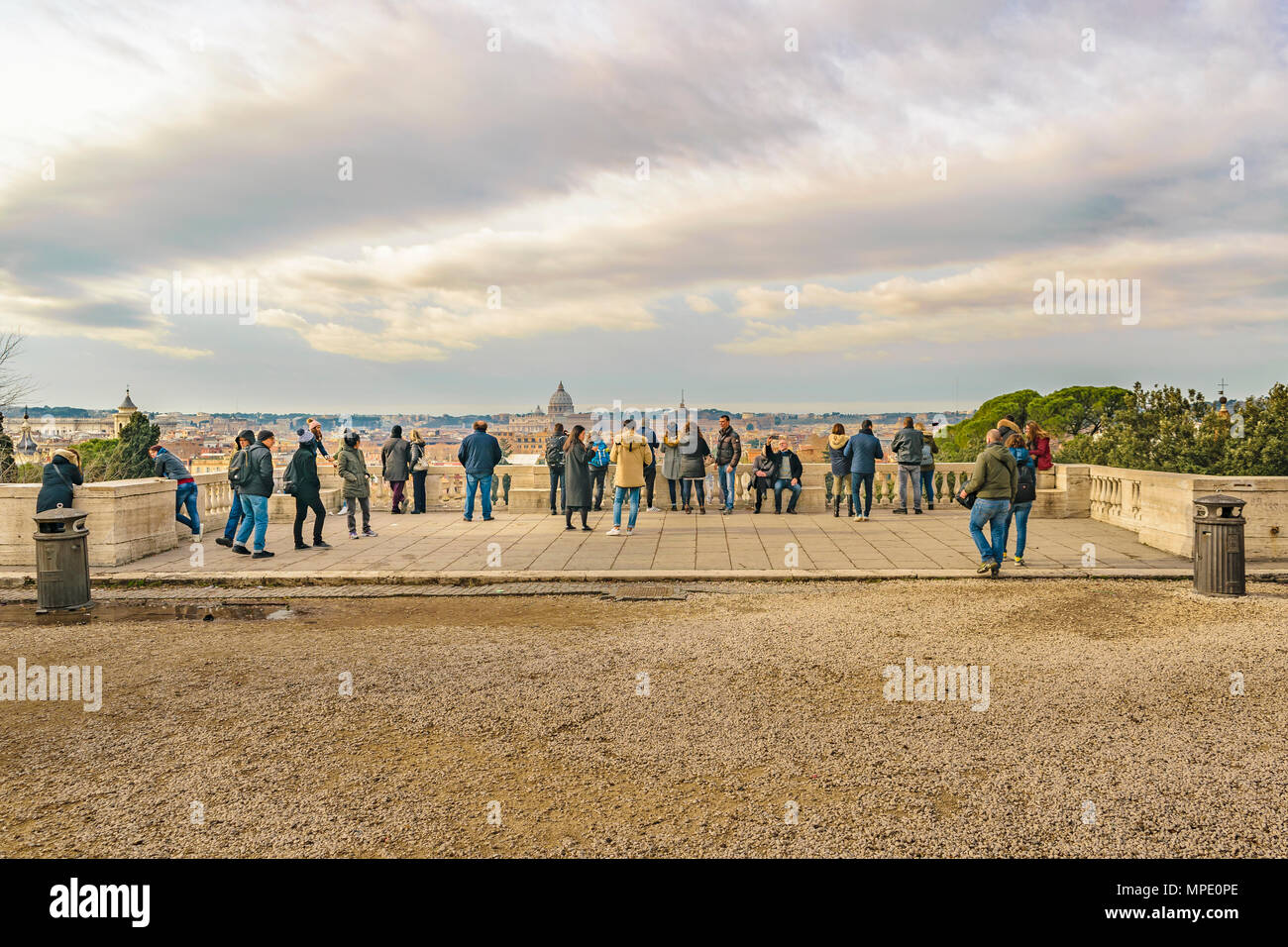 ROME, ITALY, DECEMBER - 2017 - Group of tourist watching and taking photos of Rome cityscape from monte pincio viewpoint. - Stock Image