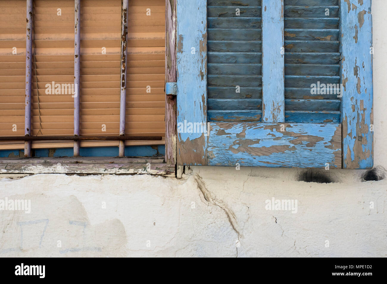 Old Vintage Wooden Shutter Doors Painted In Blue Paint Fall Off And Wooden Blinds Are Brown The Old Window On The Wall With Cracks Stock Photo Alamy