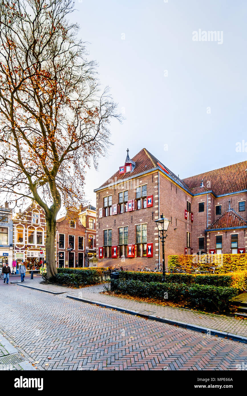 Typical Dutch traditional brick street with historical Dutch brick homes and buildings in  the city of Zwolle in Overijssel, the Netherlands Stock Photo
