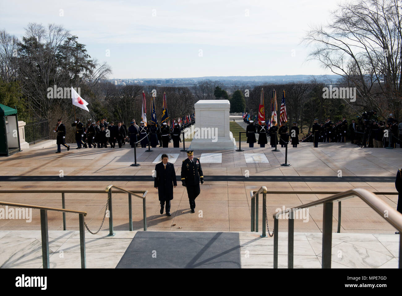 Shinzo Abe, left, prime minster of Japan, is escorted by Maj. Gen. Mark S. Inch, commanding general, U.S. Army Criminal Investigation Command and U.S. Army Correction Command, during a full-honors wreath ceremony at Arlington National Cemetery, Feb. 10, 2017, in Arlington, Va. Abe placed a wreath at the Tomb of the Unknown Soldier during the ceremony. (U.S. Army photo by Rachel Larue/Arlington National Cemetery/released) - Stock Image
