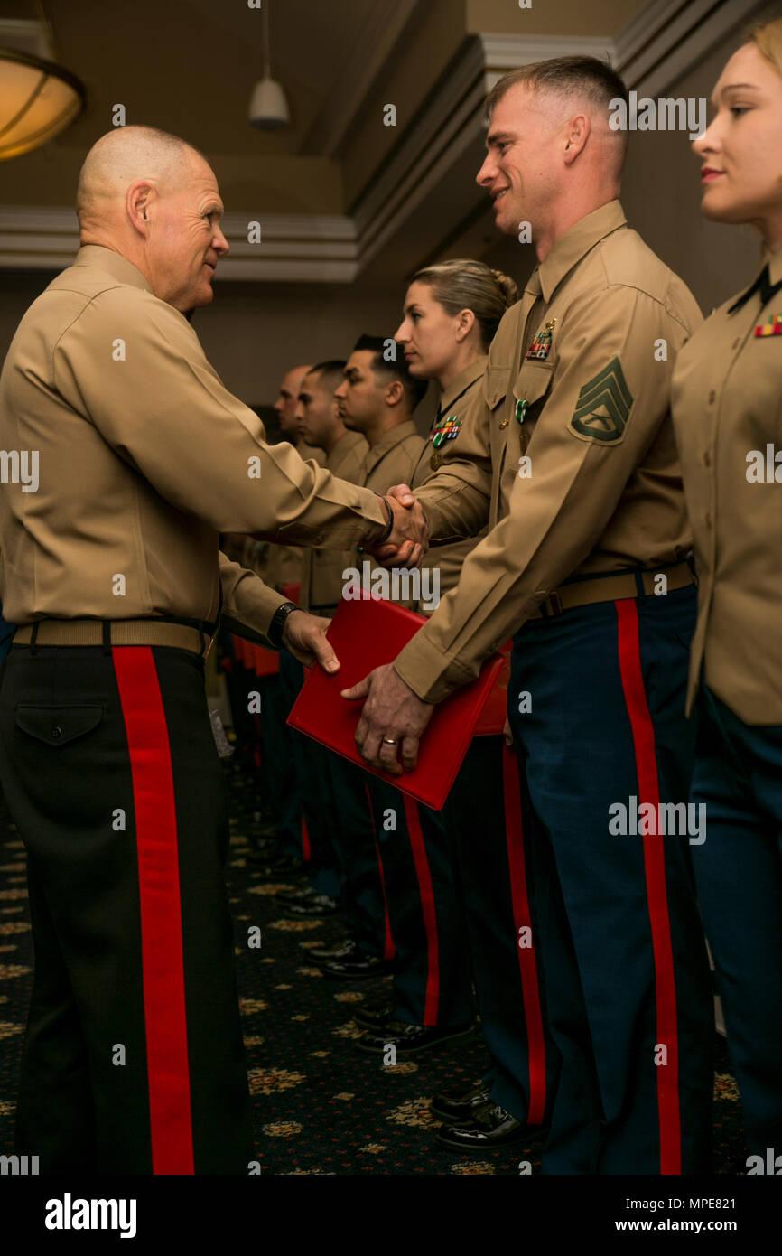 the commandant of the marine corps gen robert b neller shakes the