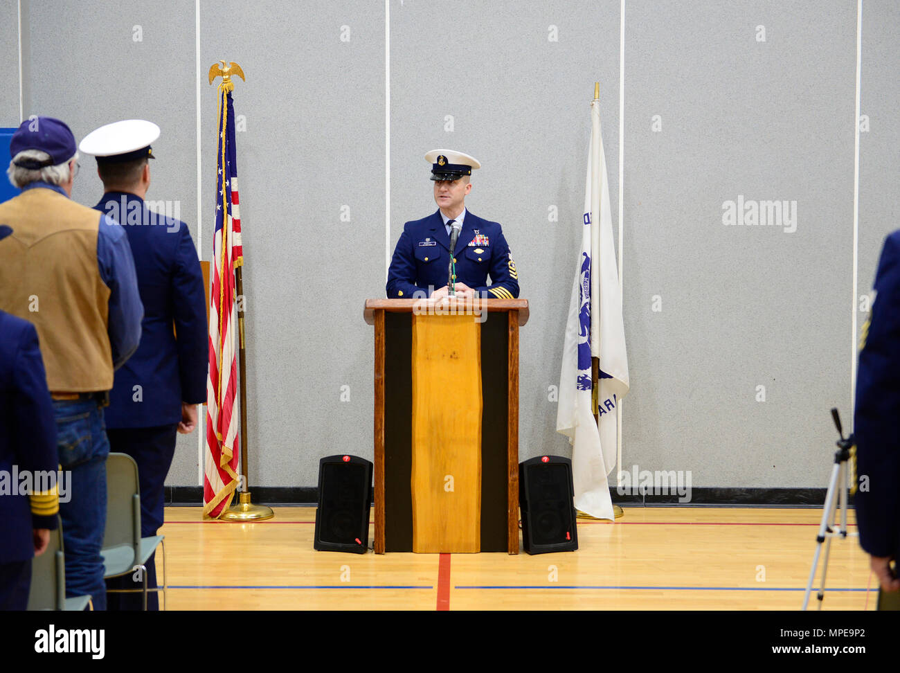 Senior Chief Petty Officer Cory Wadley, the officer in charge of Coast Guard Station Quillayute River, delivers his remarks during a remembrance ceremony at his station in La Push, Wash., Sunday, Feb 12, 2017. The remembrance ceremony honored the 20-year anniversary of the loss of three Coast Guardsmen aboard Coast Guard Motor Lifeboat 44363. U.S. Coast Guard photo by Chief Petty Officer Nick Ameen - Stock Image