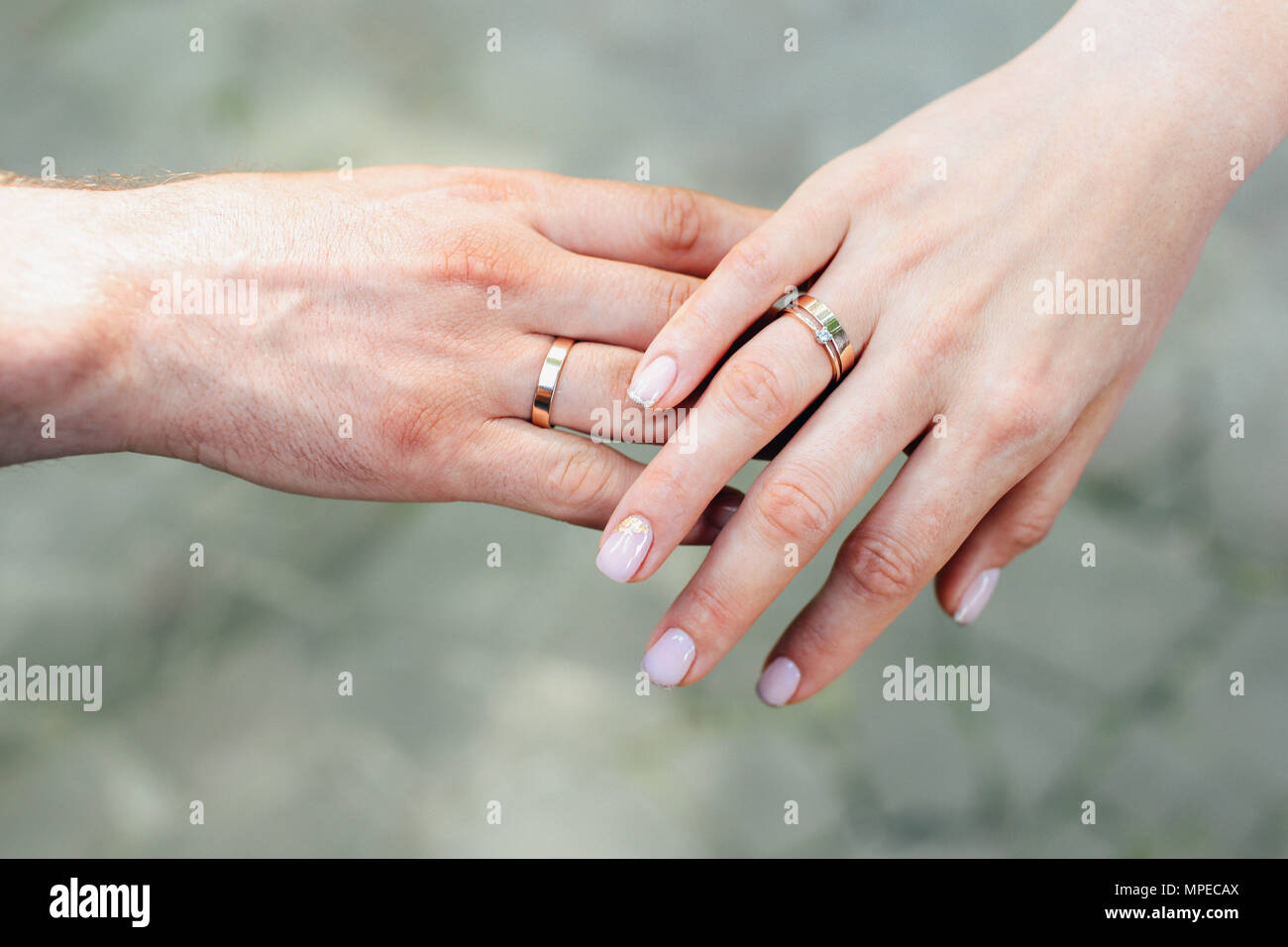 Close-Up Of Hands Of Couple with wedding rings Stock Photo ...