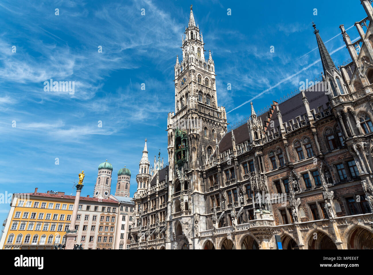 The townhall at the Marienplatz in Munich with the towers of the Frauenkirche in the back - Stock Image