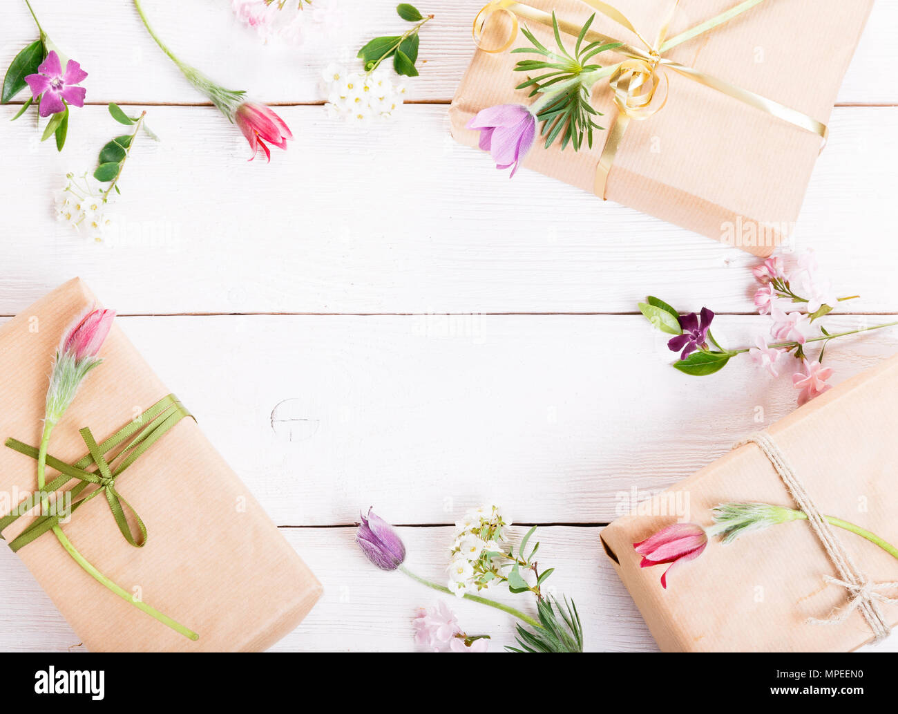 Gift and roses on wooden white background. Workspace. Top view, flat lay Stock Photo