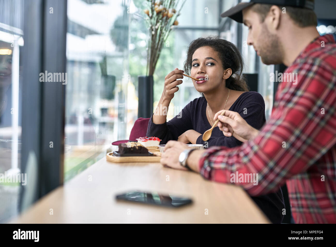 Dating of interracial couple - Stock Image