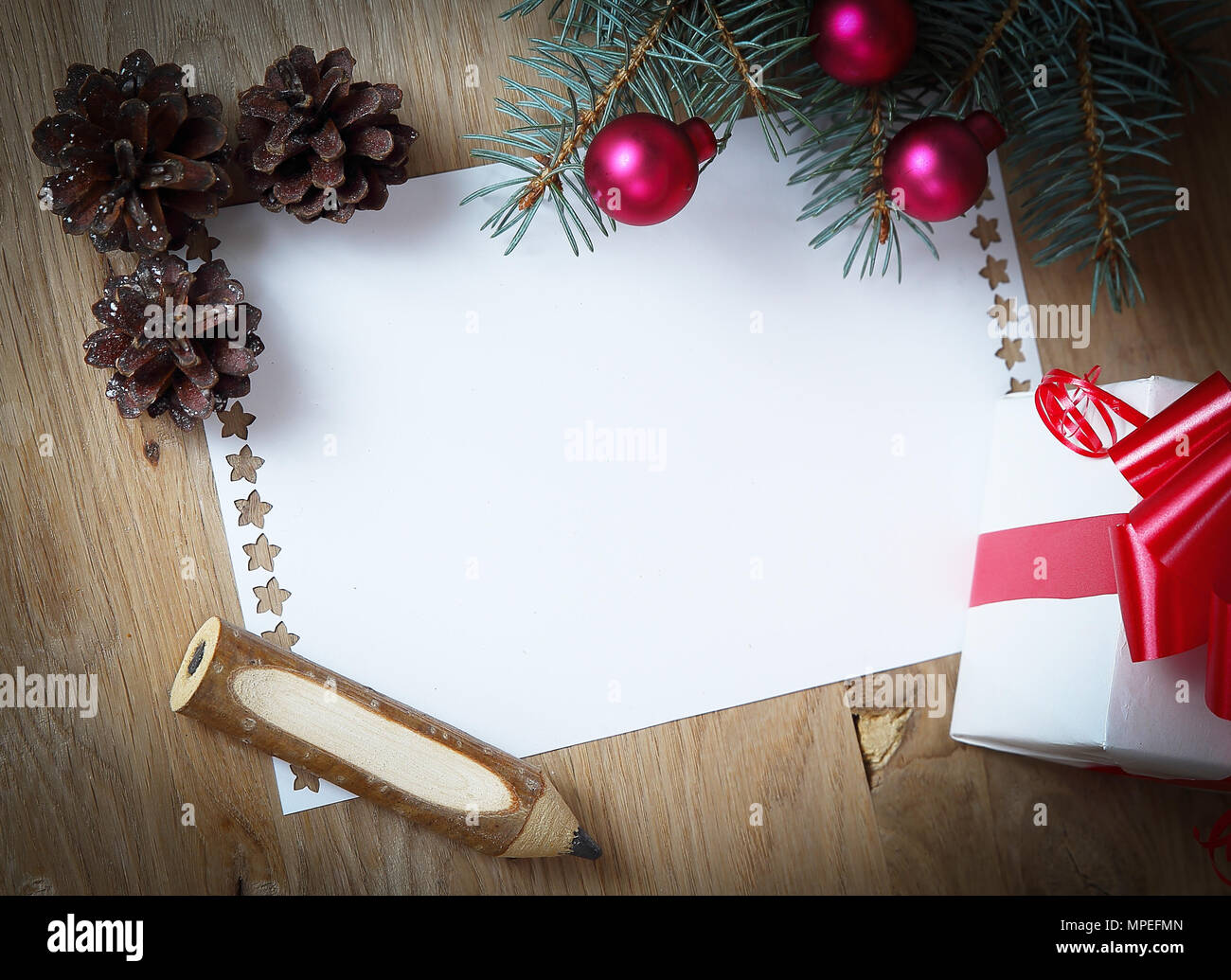 blank christmas card and ornaments on wooden background - Christmas Card Ornaments