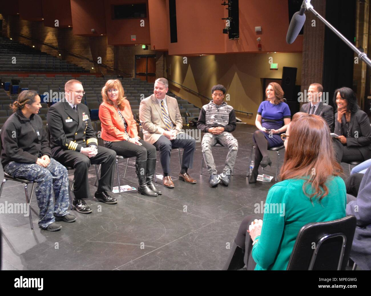 170215-N-KW311-002 BREMERTON, Wash. (Feb. 15, 2017) – Local community members, including Capt. Alan Schrader, Naval Base Kitsap (NBK) commanding officer, school board representatives, high school students, and community leaders, discuss hot topics and share ideas during a roundtable organized by KING-TV Seattle at the Bremerton High School Performing Arts Center. The dialogue was arranged to address the community's health and economic growth. (U.S. Navy photo by Aviation Ordnanceman Airman Ayana Happel/Released) - Stock Image