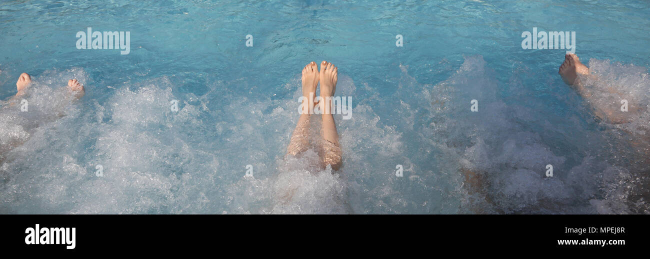 Many feet during the whirlpool therapy in the pool of the spa Stock ...
