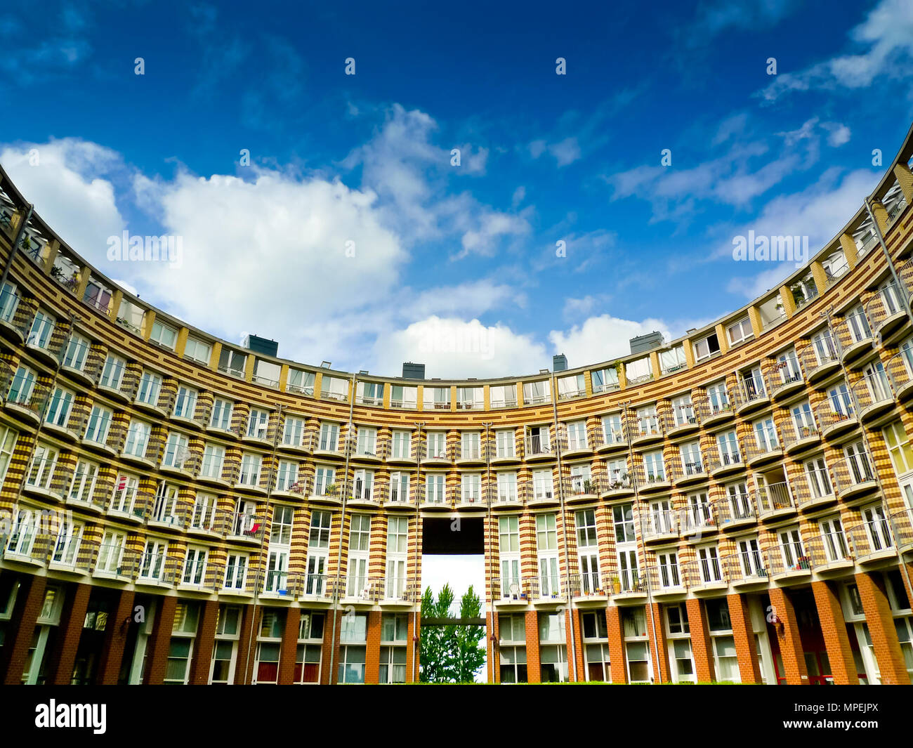Circular residential building in Ertshaven, Amsterdam's Eastern Docklands, Netherlands - Stock Image