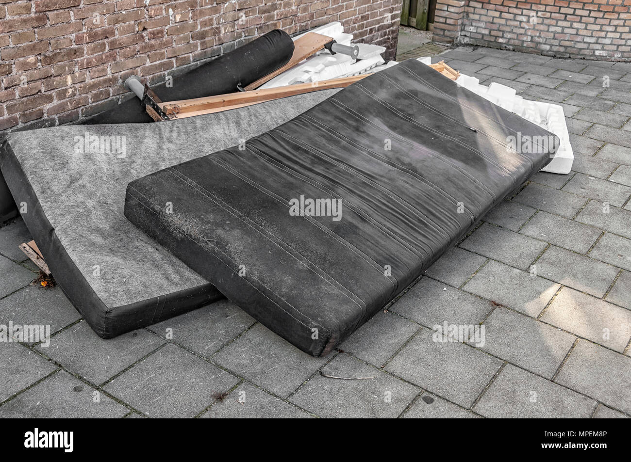 used mattresses dumped on the street - Stock Image