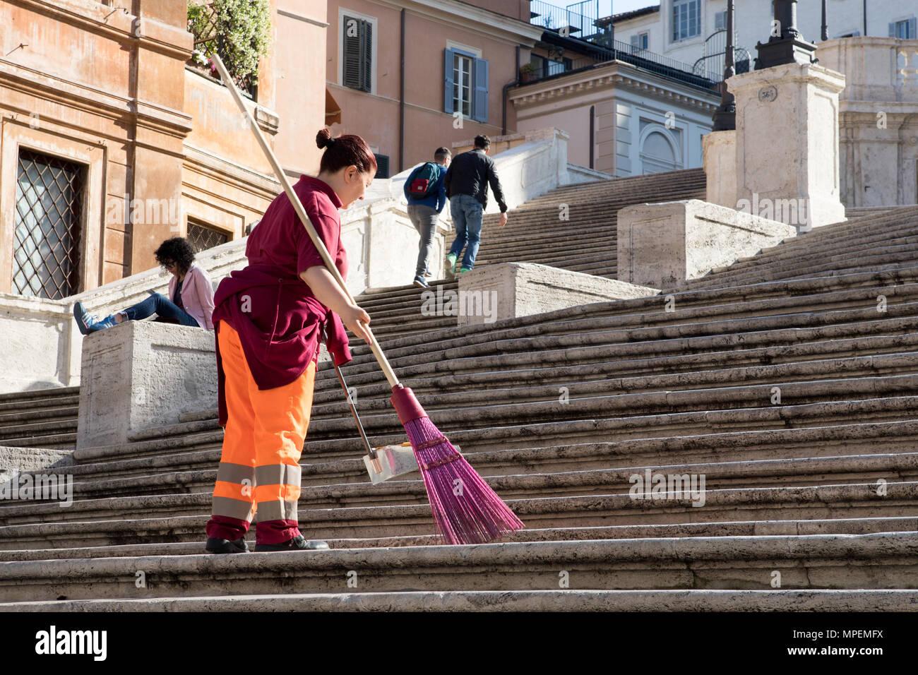 Rome Trinita de Monti, Municipal clean up worker woman  AMA cleaning Spanish  steps. - Stock Image