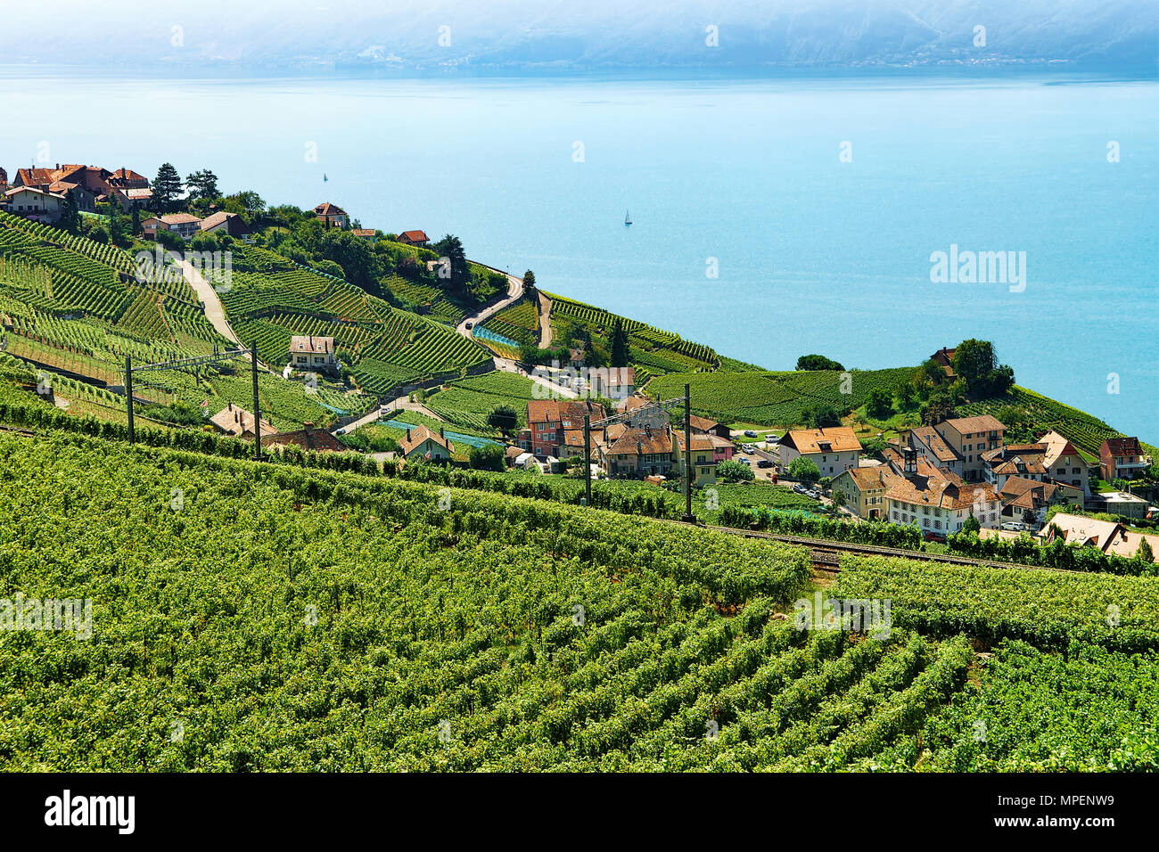 Lavaux, Switzerland - August 30, 2016: Railway line, Lavaux Vineyard Terraces hiking trail, Lake Geneva and Swiss mountains, Lavaux-Oron district, Swi - Stock Image
