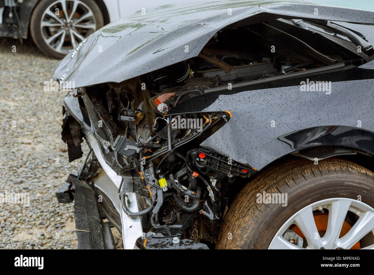 Broken car after accident, view of car front down after an explosion, ready to be scrapped Stock Photo