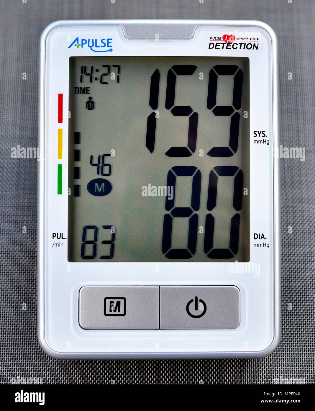 Upper Arm Digital Blood Pressure Monitor 159/80 mmHg - Stock Image