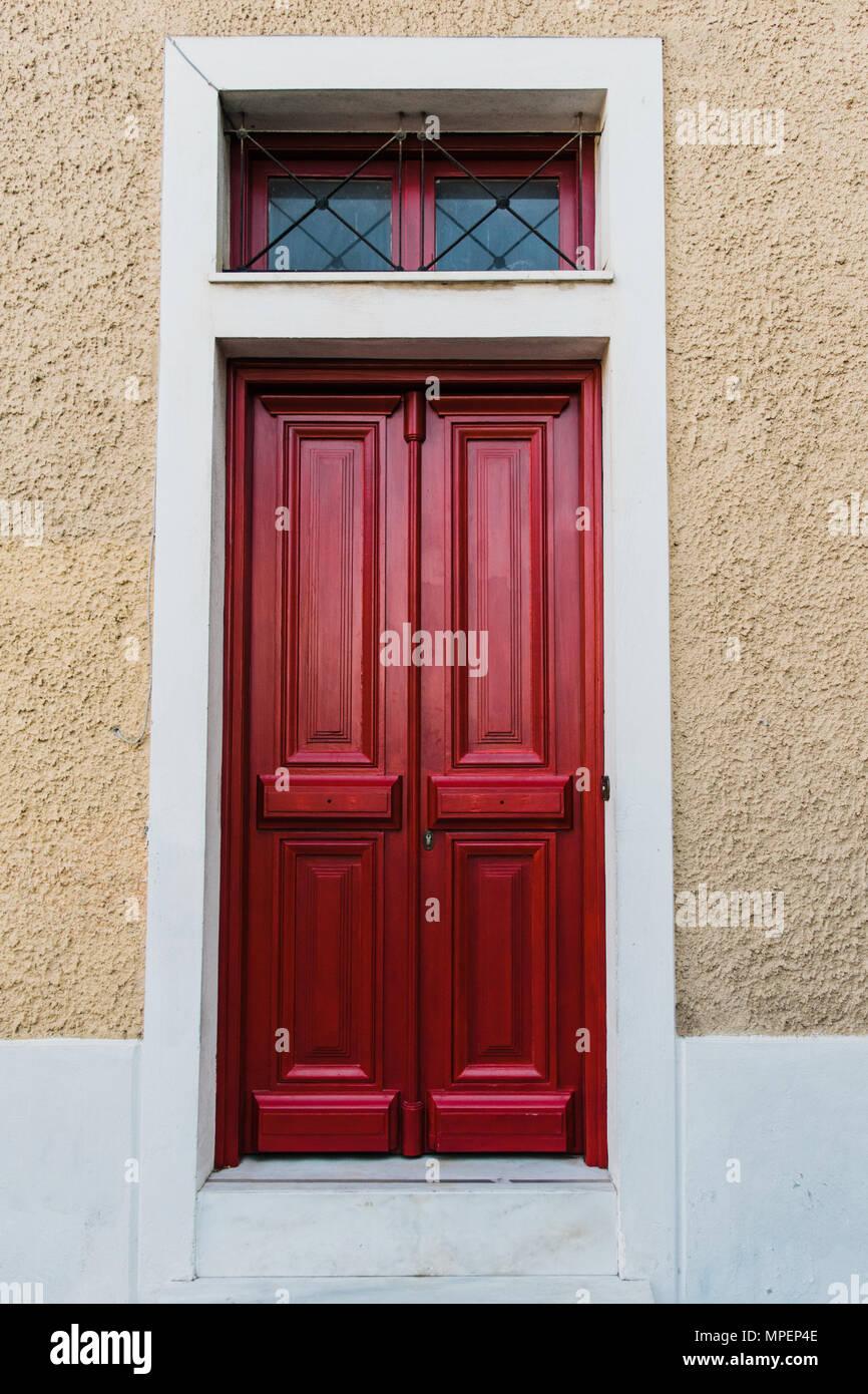 Vintage red wooden paneled front door. Athens. Greece. - Stock Image - Antique Front Doors Stock Photos & Antique Front Doors Stock Images
