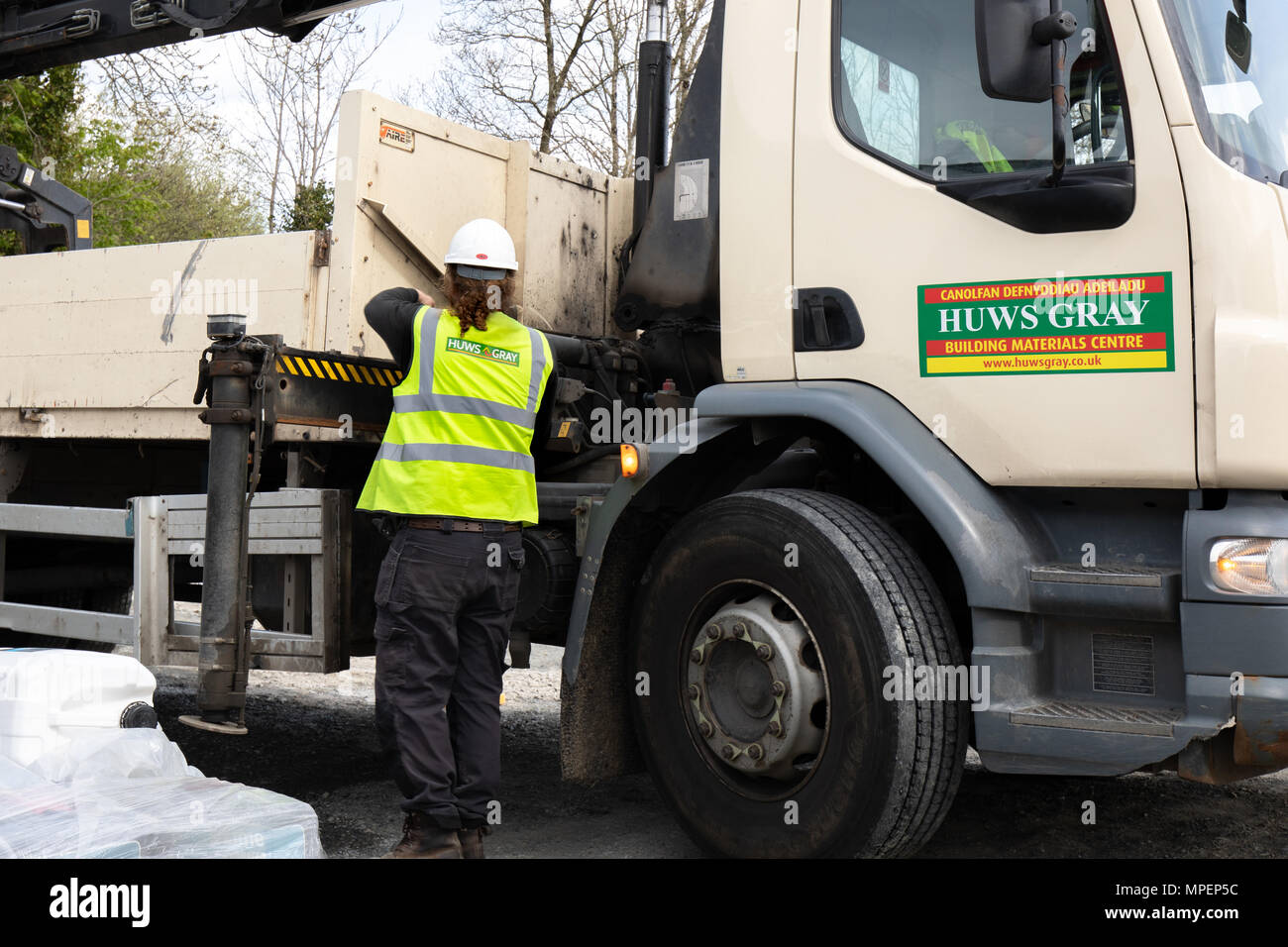 A Huws Gray builders merchant lorry delivering building products Stock Photo