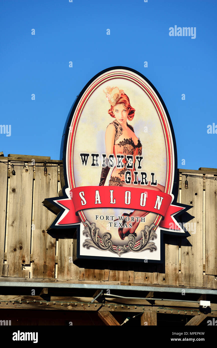 Advertising sign for Whiskey Girl Saloon, Stockyards National Historic District, Fort Worth, Texas, USA - Stock Image
